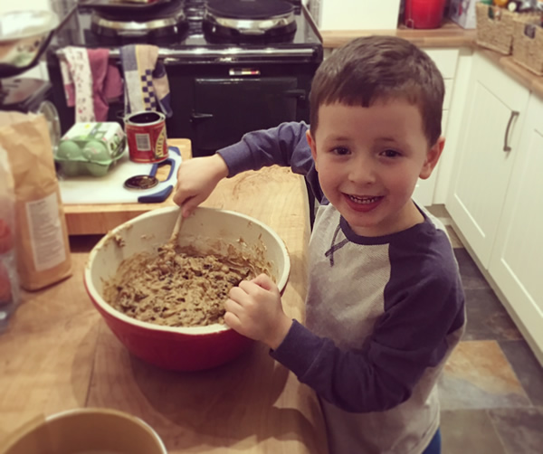 Vicki's son (James) making some christmas cakes